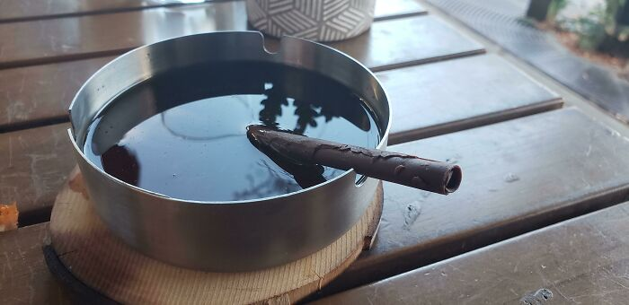 Cocktail In Ash Tray With Chocolate Cigar Straw